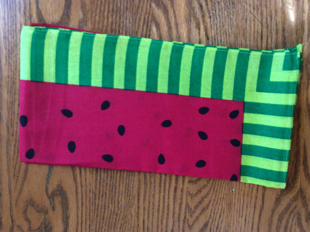 Red interior with black watermelons seeds with a border of lime/green stripes