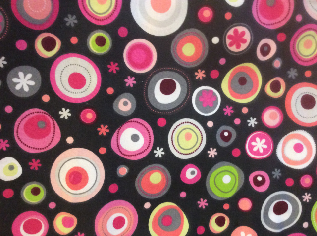 Charcoal background with bright circles of color in varying sizes.  Circle colors include pink, hot