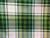 Large bold green/black/white/gold plaid